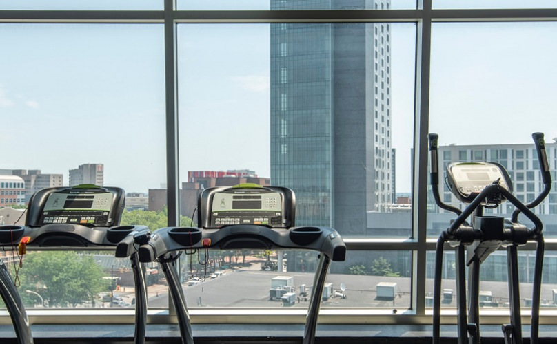 cardio equipment with city views in fitness center