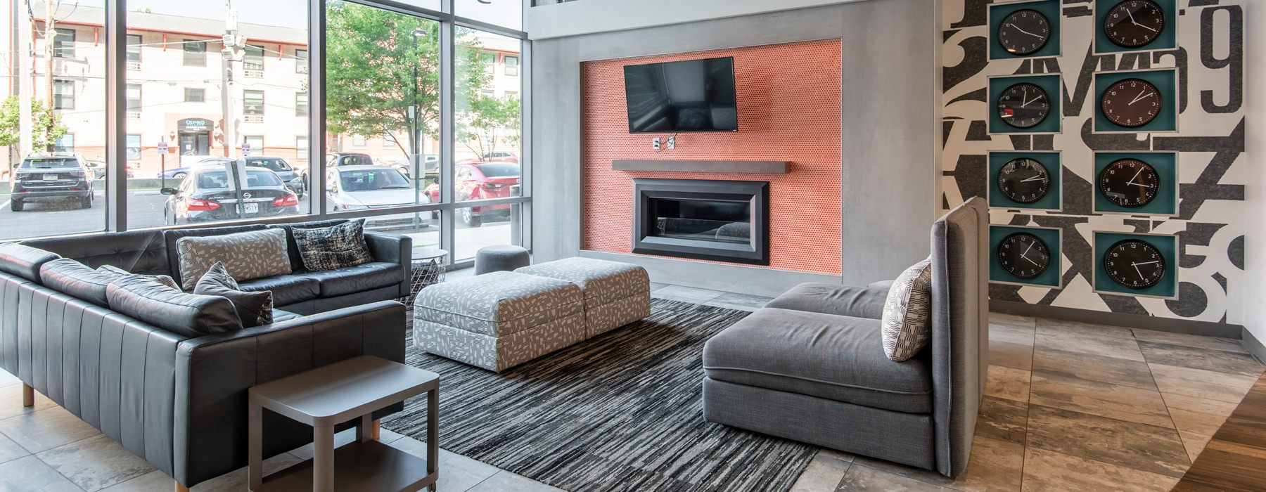 spacious resident lounge with fireplace and tv